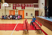 Seventh grader Jaz Reyes, center, looks on as eighth grader Vanessa Cho spells a word during the final round of the 1st Annual Spelling Bee at Rancho Middle School in Milpitas, California, on December 9, 2015. Participants who spelt words incorrectly sit along the far wall. (Stan Olszewski/SOSKIphoto)