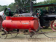 Side view of an antique J.I. Case water wagon, with antique steam engines behind; Rock River Thresheree, Edgerton, Wisconsin; 2 Sept 2013