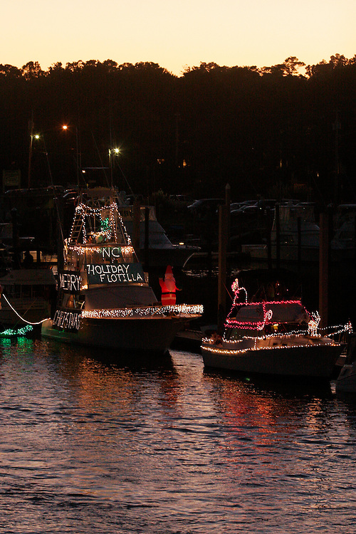 As the sun sets, Bob Bleekers boat waits in the ICW at Wrightsville Beach as the North Carolina Holiday Flotilla prepares to get underway...Photo by Logan Mock-Bunting