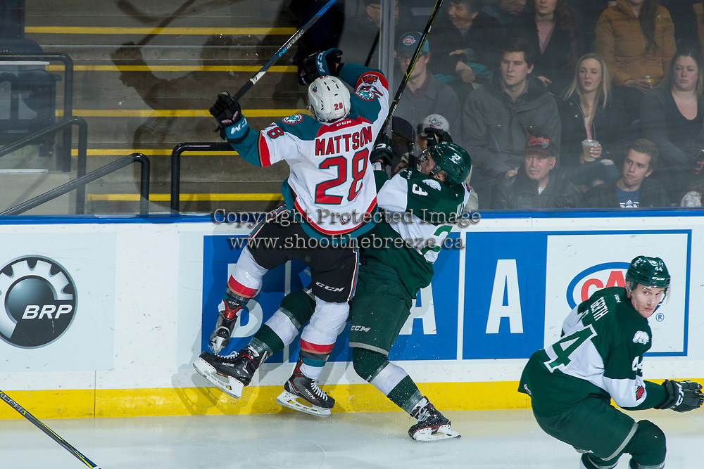 KELOWNA, CANADA - FEBRUARY 2: Leif Mattson #28 of the Kelowna Rockets checks Wyatte Wylie #29 of the Everett Silvertips at the boards during first period on FEBRUARY 2, 2018 at Prospera Place in Kelowna, British Columbia, Canada.  (Photo by Marissa Baecker/Shoot the Breeze)  *** Local Caption ***