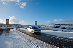 © Licensed to London News Pictures. 17/01/2015. Motorists drive through a wintry landscape on the Mynydd Epynt moorland on the B4520 'Brecon Road' between Brecon and Builth Wells. There was overnight snowfall on high land in Mid Wales. Mynydd Epynt, Powys , Wales, UK. Photo credit: Graham M. Lawrence/LNP