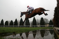 Red Infantry ridden by Robert Dunne jump the water ditch on their way to winning The Sky Bet Top Price Promise Steeple Chase at Doncaster Racecourse.