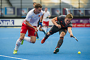 England's Harry Martin is tackled by Floris Wortelboer of the Netherlands. England v The Netherlands - Semi Final - Hockey World League Semi Final, Lee Valley Hockey and Tennis Centre, London, United Kingdom on 24 June 2017. Photo: Simon Parker
