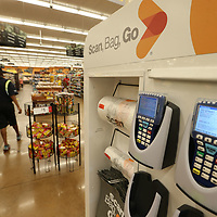 Scanner wait to be picked up and used by customers at the Kroger location near crosstown where customers can scan thier groceries as they select them to speed up their shopping.