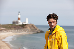 handsome man on the beach near the Montauk Lighthouse in Montauk, NY