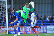 Craig MacGillvray claims the ball under pressure from Aaron Wilbraham during the EFL Sky Bet League 1 match between Rochdale and Portsmouth at Spotland, Rochdale, England on 29 September 2018.