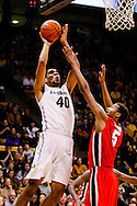 December 28th, 2013:  Colorado Buffaloes sophomore forward Josh Scott (40) pulls up for a shot attempt over Georgia Bulldogs junior forward Tim Dixon (5) in the first half of the NCAA Basketball game between the Georgia Bulldogs and the University of Colorado Buffaloes at the Coors Events Center in Boulder, Colorado
