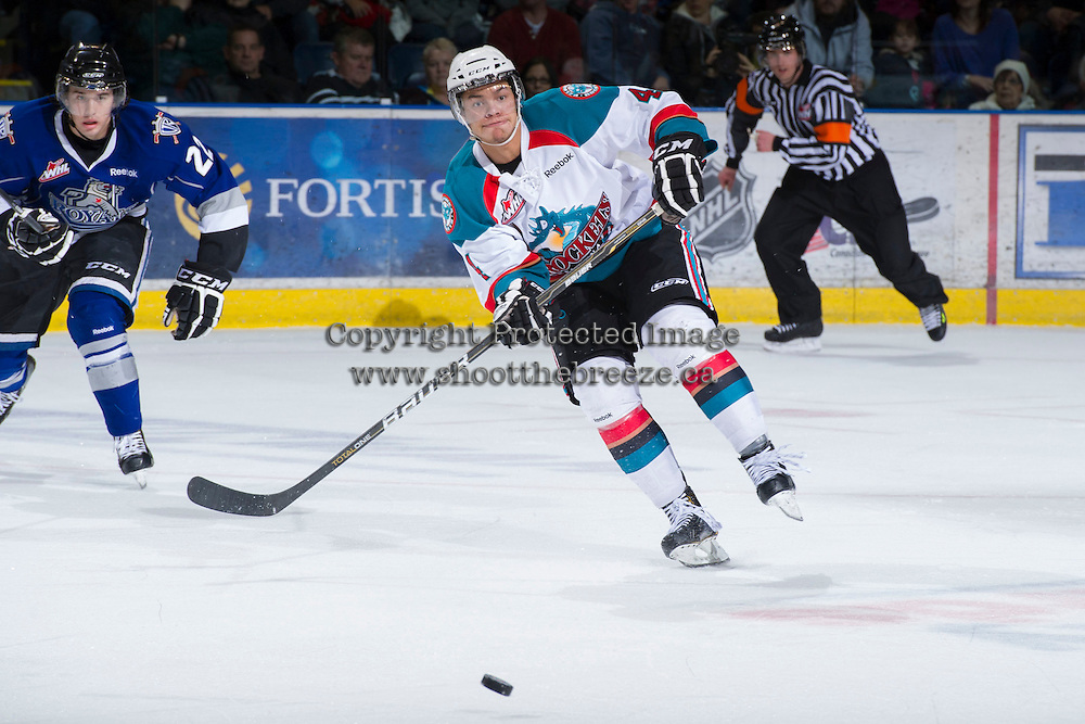 KELOWNA, CANADA - JANUARY 2:  Madison Bowey #4 of the Kelowna Rockets pass the puck on the ice against Victoria Royals at the Kelowna Rockets on January 2, 2013 at Prospera Place in Kelowna, British Columbia, Canada (Photo by Marissa Baecker/Shoot the Breeze) *** Local Caption ***