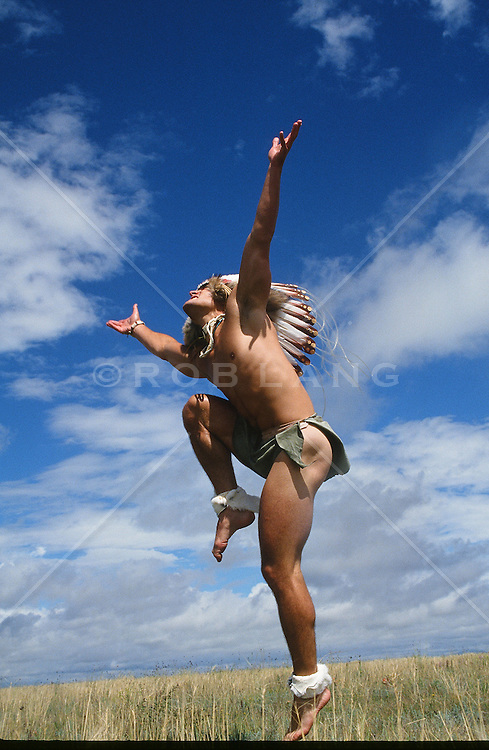 sexy American Indian doing a dance outdoors