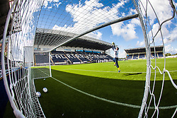 Falkirk FC keeper Michael McGovern seen through the goal net during the warm-up. The Falkirk Stadium, with the new pitch work for the Scottish Championship game v Morton. The woven GreenFields MX synthetic turf and the surface has been specifically designed for football with 50mm tufts compared with the longer 65mm which has been used for mixed football and rugby uses.  It is fully FFA two star compliant and conforms to rules laid out by the SPL and SFL.<br />