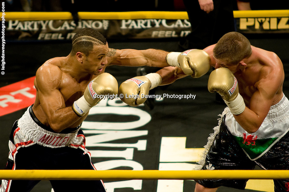 Young Mutley (black,red stripe shorts) defeats Barrie Jones at London Olympia -  Prizefighter Light Welterweights 4th December 2009 Credit: © Leigh Dawney Photography