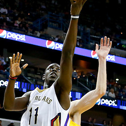 Nov 8, 2013; New Orleans, LA, USA;  New Orleans Pelicans point guard Jrue Holiday (11) shoots against the Los Angeles Lakers during the first quarter of a game at New Orleans Arena. Mandatory Credit: Derick E. Hingle-USA TODAY Sports