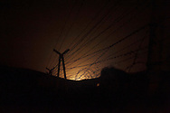 SYRIA. Night shot of barbwire in an undisclosed place of the Turkish-Syrian border on April 10, 2012. ALESSIO ROMENZI