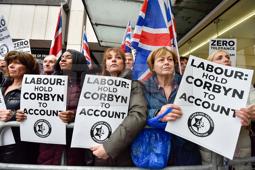 © Licensed to London News Pictures. 08/04/2018. LONDON, UK. Women with signs at a protest calling for Jeremy Corbyn, leader of the Labour party, to be held to account.  The event was organised by the Campaign Against Anti-Semitism, outside the Labour Party's headquarters in central London.  Photo credit: Stephen Chung/LNP
