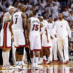 Jun 18, 2013; Miami, FL, USA; Miami Heat point guard Mario Chalmers (15) talks with center Chris Bosh (1) during the first quarter of game six against the San Antonio Spurs in the 2013 NBA Finals at American Airlines Arena.  Mandatory Credit: Derick E. Hingle-USA TODAY Sports