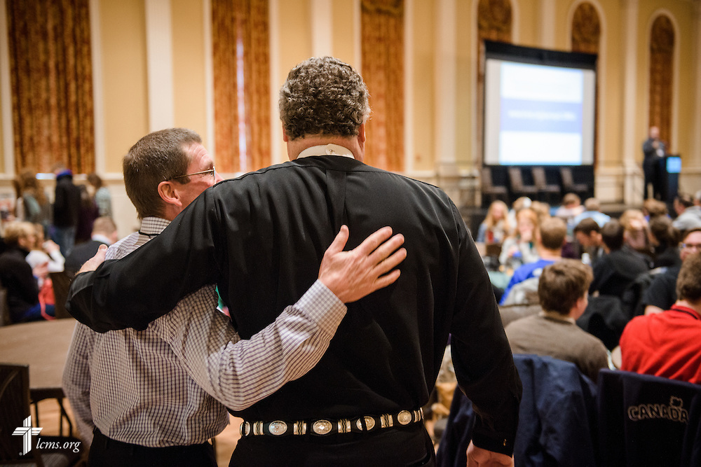 "The Rev. Terry R. Forke, president of Montana District, and the Rev. Dr. Matthew C. Harrison, president of The Lutheran Church–Missouri Synod, greet each other the morning after ""the Great Mustache Shave Off"" at the Liberty National LCMS Campus Ministry Conference on Thursday, Jan. 5, 2017, at the University of Maryland in College Park, Md. LCMS Communications/Erik M. Lunsford"