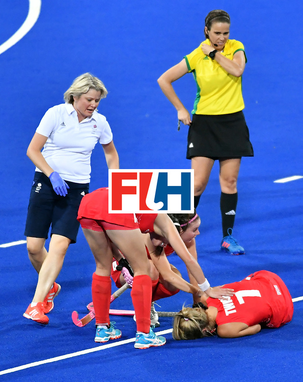 Britain's Georgie Twigg (bottom) lies on the field after resulting injuried during the women's semifinal field hockey New Zealand vs Britain match of the Rio 2016 Olympics Games at the Olympic Hockey Centre in Rio de Janeiro on August 17, 2016. / AFP / Pascal GUYOT        (Photo credit should read PASCAL GUYOT/AFP/Getty Images)