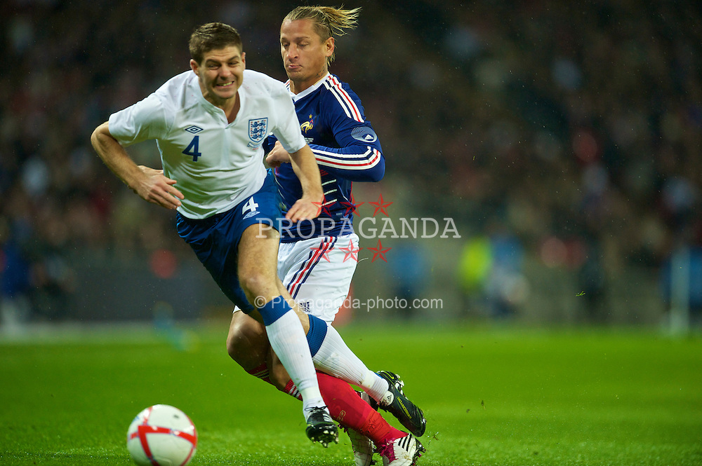 LONDON, ENGLAND - Wednesday, November 17, 2010: England's Steven Gerrard in action against France's Philippe Mexes during the International Friendly match at Wembley Stadium. (Pic by: David Rawcliffe/Propaganda)