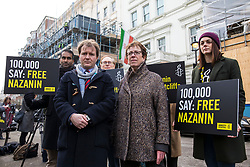 © Licensed to London News Pictures. 21/02/2018. London, UK. Richard Ratcliffe (2-R), husband of Nazanin Zaghari-Ratcliffe, joins protesters outside the Iranian Embassy in London, ahead of an expected visit by a senior Iranian minister. British-Iranian Nazanin Zaghari-Ratcliffe has been detained in Iran since April 2016. Photo credit: Rob Pinney/LNP