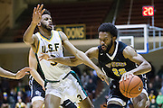 San Francisco State forward Derrick Brown (22) attacks the San Francisco Dons defense at Kezar Pavilion in San Francisco, Calif., on December 6, 2016. (Stan Olszewski/Special to S.F. Examiner)