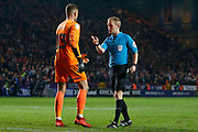 Referee Gavin Ward warns Doncaster Rovers goalkeeper Marko Marosi (13) before the penalties start during the EFL Sky Bet League 1 second leg Play-Off match between Charlton Athletic and Doncaster Rovers at The Valley, London, England on 17 May 2019.