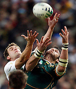Photo: Richard Lane/Sportsbeat Images.<br /> England v South Africa. The Final of the IRB Rugby World Cup, RWC 2007. 20/10/2007. <br /> England's Mark Cueto and South Africa's Victor Matfield go for a high ball.