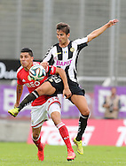Portugal, FUNCHAL :Benfica's Uruguayan midfielder Enzo Perez  vies with Nacional´s Portuguese defender Miguel Rodrigues during the Portuguese league football match CD Nacional vs Benfica at the Madeira stadium in Funchal on November 09, 2014.  AFP PHOTO / GREGORIO CUNHA