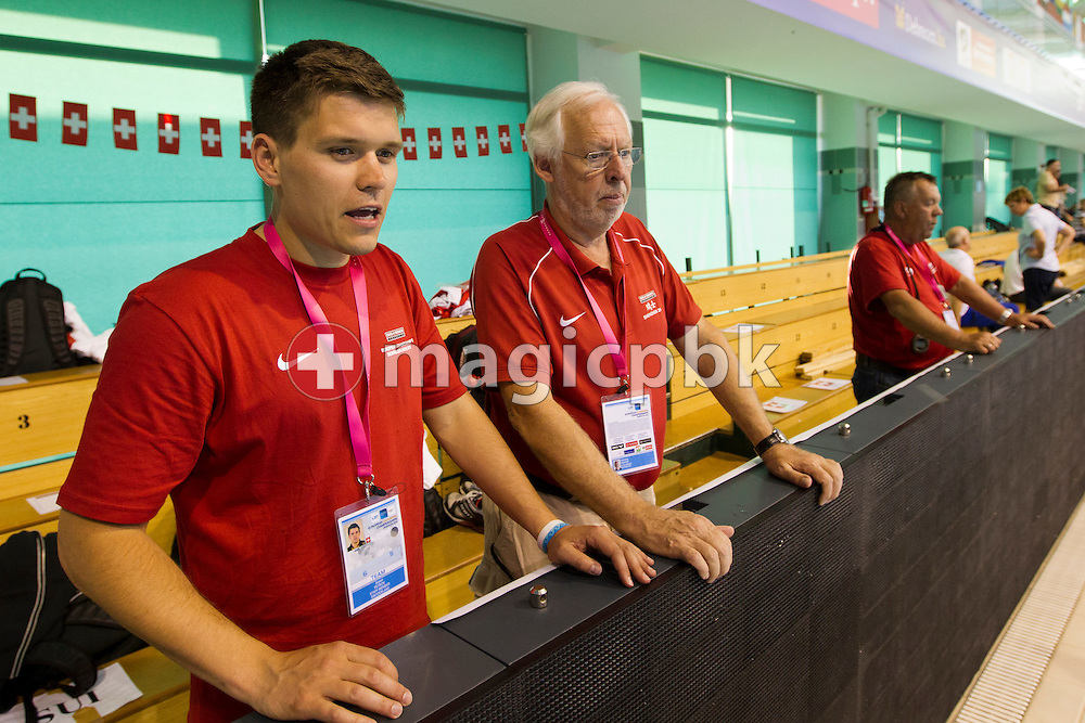 (L-R) Coaches of Team Switzerland Arpad PETROV, Flemming POULSEN and Guennadi TOURETSKI (Gennadi TURETSKI) supervise a training session two days prior to the 31st LEN European Swimming Championships in Debrecen, Hungary, Saturday, May 19, 2012. (Photo by Patrick B. Kraemer / MAGICPBK)
