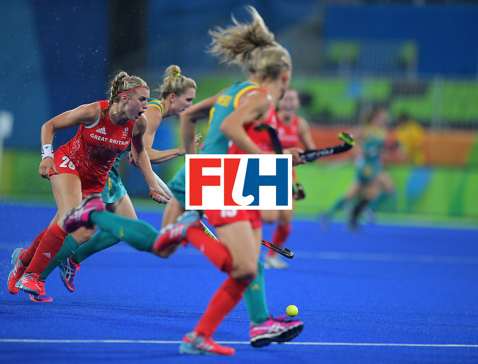 Britain's Lily Owsley (L) shouts as she chases the ball during the women's field hockey Britain vs Australia match of the Rio 2016 Olympics Games at the Olympic Hockey Centre in Rio de Janeiro on August, 6 2016. / AFP / Carl DE SOUZA        (Photo credit should read CARL DE SOUZA/AFP/Getty Images)