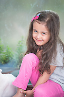 Portrait of cute little girl relaxing at home