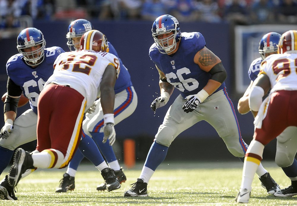 EAST RUTHERFORD, NJ - SEPTEMBER 13: David Diehl #66 of the New York Giants blocks against the Washington Redskins during their game on September 13, 2009 at Giants Stadium in East Rutherford, New Jersey. (Photo by Rob Tringali) *** Local Caption ***David Diehl