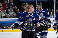 KELOWNA, CANADA - JANUARY 2:  Jamie Crooks #15 of the Victoria Royals watches the replay as he skates to the bench at the Kelowna Rockets on January 2, 2013 at Prospera Place in Kelowna, British Columbia, Canada (Photo by Marissa Baecker/Shoot the Breeze) *** Local Caption ***