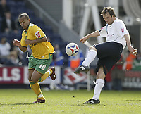 Photo: Aidan Ellis.<br /> Preston North End v Norwich City. Coca Cola Championship. 08/04/2006.<br /> preston's Marcus Stewart clears from Norwich's Robert Earnshaw