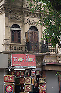 An ornate old building with a shop below selling tacky souvenirs in the Old Quarter, Hanoi, Vietnam, Southeast Asia