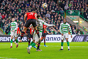 Sacha Boey (31) of Rennes goes through Celtic's Greg Taylor (#3) during the Europa League match between Celtic and Rennes at Celtic Park, Glasgow, Scotland on 28 November 2019.