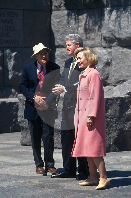 President Bill Clinton and First Lady Hillary during a walk through of the FDR Memorial May 2, 1997 in Washington, DC. Accompanying the Clintons is sculptor Neil Estrin.