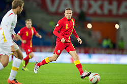 CARDIFF, WALES - Friday, October 11, 2013: Wales' Craig Bellamy in action against Macedonia during the 2014 FIFA World Cup Brazil Qualifying Group A match at the Cardiff City Stadium. (Pic by David Rawcliffe/Propaganda)