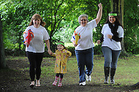 Kerry Clare, Isobel Clare, 3, Tracey Gellatly and Charlotte Blackshaw all at The Olympic Torch Relay passes through Hatfield, Herts,