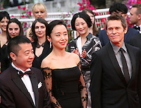 Zhangke Jia, Do Yeon Jeon and Willem Dafoe at the the Grace of Monaco gala screening and opening ceremony red carpet at the 67th Cannes Film Festival France. Wednesday 14th May 2014 in Cannes Film Festival, France.