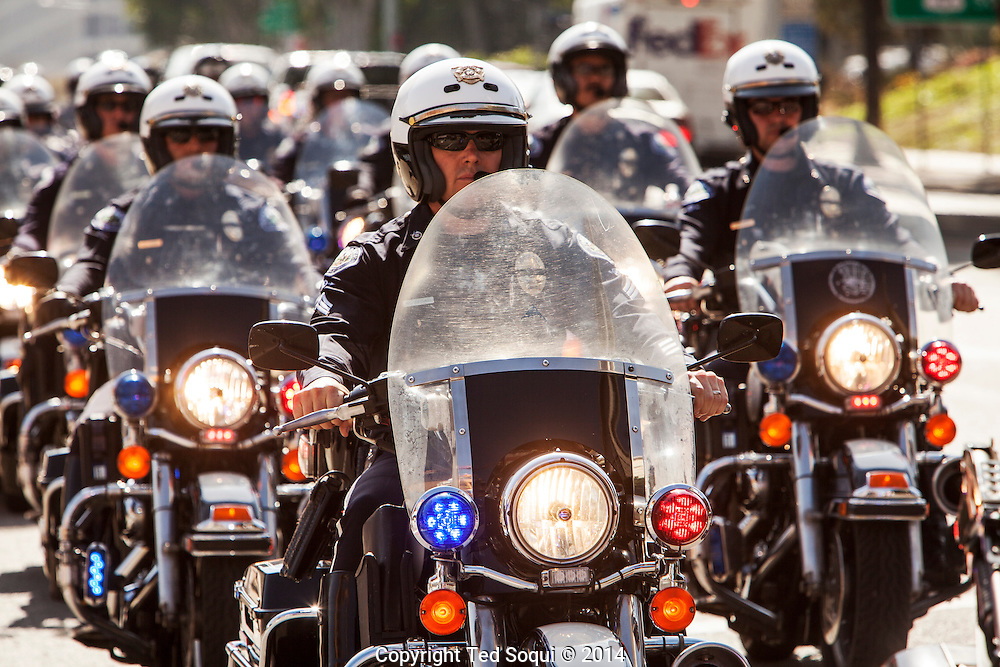An End of Watch memorial service was held for fallen LAPD Officer Nicholas Choung Lee. Officer Lee was killed on duty in a traffic collision last Friday, March 7, 2014. <br /> Thousand of law enforcement officers from all over California showed up to the memorial, held at the Our Lady Queen of Angels Cathedral in downtown LA, to show their respects.