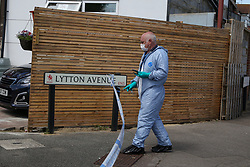 © Licensed to London News Pictures. 17/07/2020. London, UK. A forensic officer on Lytton Avenue, Enfield, in north London as police launch a murder investigation following the death of a man in his 30s. Police were called at 04:45hrs on early this morning, tPolice were called at 04:45hrs early this morning, to a report of four men fighting in Lytton Avenue, Enfield and a man being put into a vehicle. Later the victim died from a single stab wound in North Middlesex Hospital. Three men, no further details, have been arrested on suspicion of murder; all remain in custody. Photo credit: Dinendra Haria/LNP