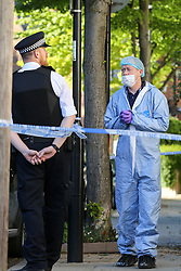 © Licensed to London News Pictures. 05/05/2020. London, UK. Police and forensic officers at a property in Dalmeny Road in Holloway, north London as police launch a <br /> murder investigation following the death of a pensioner. Police were called around 7:20pm on Monday, 4 May to reports of a man collapsed and suffering a head injury. Officers and London Ambulance Service attended. The 79-year-old man was pronounced dead at the scene and a 42-year-old man was arrested on suspicion of murder. Photo credit: Dinendra Haria/LNP