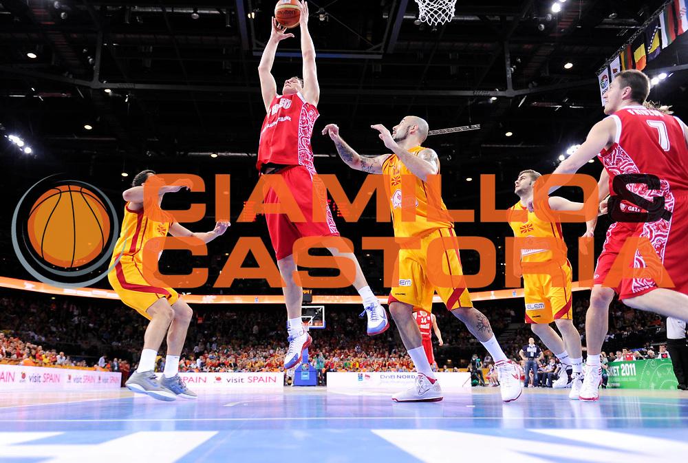 DESCRIZIONE : Kaunas Lithuania Lituania Eurobasket Men 2011 Finale Terzo Quarto Posto Classification Game for 3rd to 4th Place Macedonia Russia F.Y.R of Macedonia Russia<br /> GIOCATORE : Timofey Mozgov<br /> SQUADRA : Russia<br /> EVENTO : Eurobasket Men 2011<br /> GARA : Macedonia Russia F.Y.R of Macedonia Russia<br /> DATA : 18/09/2011 <br /> CATEGORIA : rimbalzo rebound<br /> SPORT : Pallacanestro <br /> AUTORE : Agenzia Ciamillo-Castoria/JF.Molliere<br /> Galleria : Eurobasket Men 2011 <br /> Fotonotizia : Kaunas Lithuania Lituania Eurobasket Men 2011 Finale Terzo Quarto Posto Classification Game for 3rd to 4th Place Macedonia Russia F.Y.R of Macedonia Russia<br /> Predefinita :