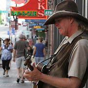 Mandolin Mike play for tips outside the bars. Nashville, also known as Music City, U.S.A., is most famous for its status as the long-time capital of country music, home to the Grand Ole Opry and the Country Music Hall of Fame. Musicians perform at the bars on Broadway&rsquo;s Honky Tonk Row in downtown Nashville.<br /> Photography by Jose More