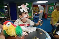 Child with physical disability learning about pirates in lesson,