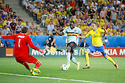 Belgium forward Romelu Lukaku (9) gets through on goal during the Euro 2016 match between Sweden and Belgium at Stade de Nice, Nice, France on 22 June 2016. Photo by Andy Walter.