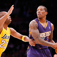 10 December 2013: Phoenix Suns point guard Eric Bledsoe (2) looks to pass the ball over Los Angeles Lakers shooting guard Jodie Meeks (20) during the Phoenix Suns 114-108 victory over the Los Angeles Lakers at the Staples Center, Los Angeles, California, USA.