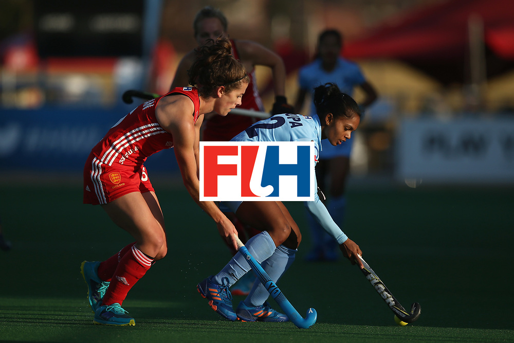JOHANNESBURG, SOUTH AFRICA - JULY 18: Anupa Barla of India and Anna Toman of England battle for possession during the Quarter Final match between England and India during the FIH Hockey World League - Women's Semi Finals on July 18, 2017 in Johannesburg, South Africa.  (Photo by Jan Kruger/Getty Images for FIH)