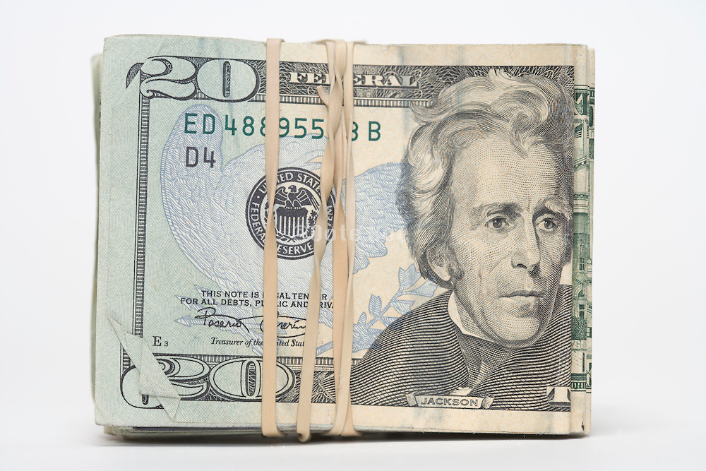 stack with twenty dollar bills hold together with rubber band