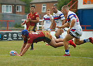 Benjamin Jullien of Catalans Dragons scores the try against Wakefield Trinity during the Betfred Super League match at the Mobile Rocket Stadium, Wakefield<br /> Picture by Stephen Gaunt/Focus Images Ltd +447904 833202<br /> 07/07/2018